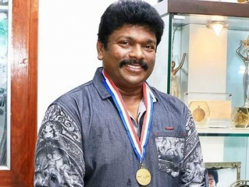 Parthiepan gets Distinguished Director Award from New York