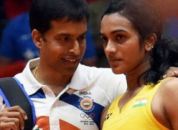 Will return Sindhu's phone, let her enjoy an ice-cream: Gopichand