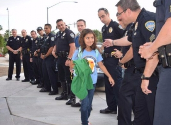 Police escort fallen officer's daughter on first day back to school