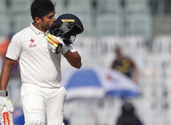Whom did Karun Nair search after hitting 300th run?