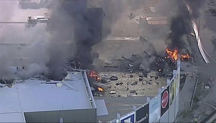 Australia plane crashes into shoping mall
