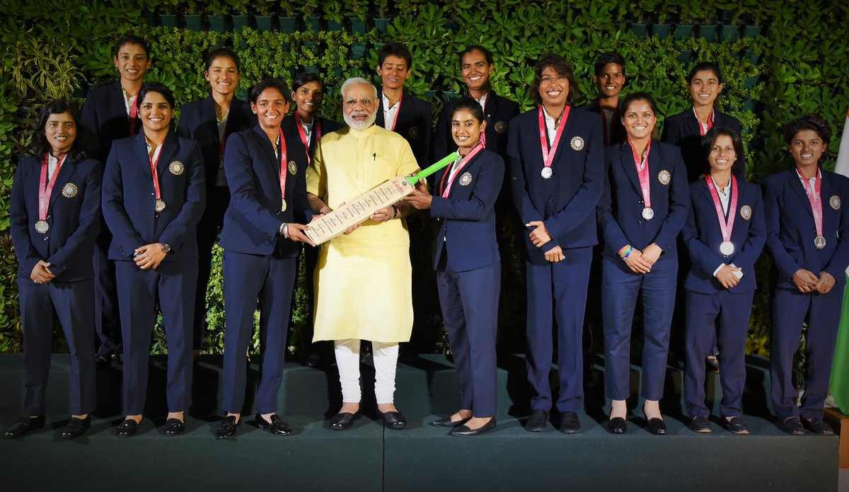 Indian women's team with modi