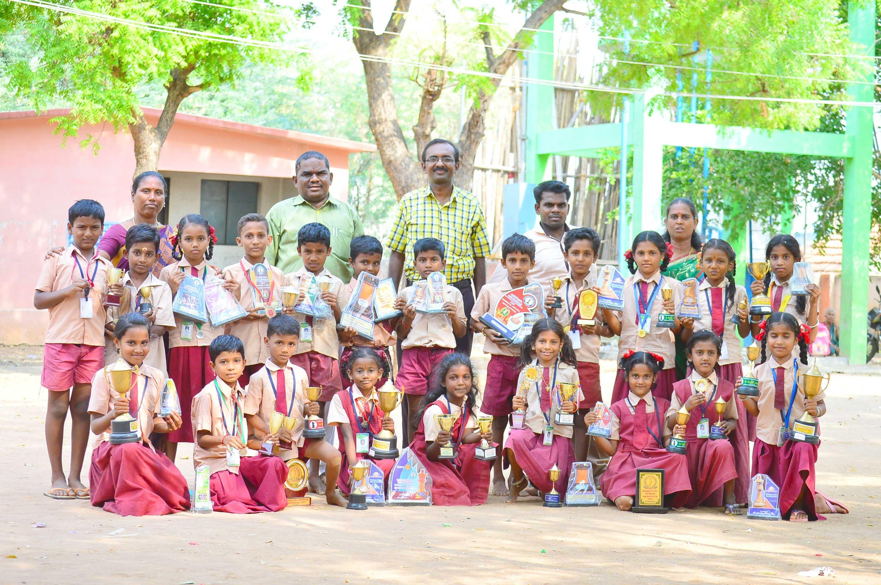 chess champian students with teachers