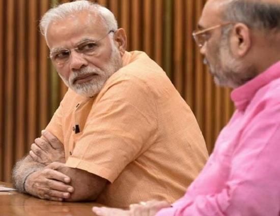 மோடியுடன் அமித் ஷா - கர்நாடகத் தேர்தல்