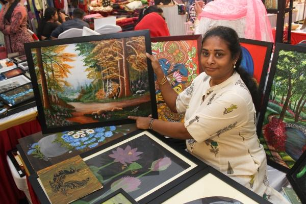 Kavitha with her work