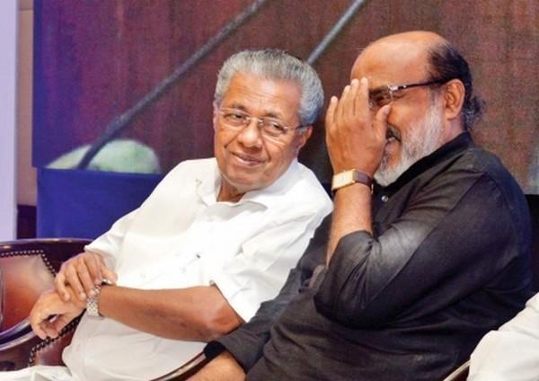 பினராயி விஜயனுடன் தாமஸ் ஐசக்