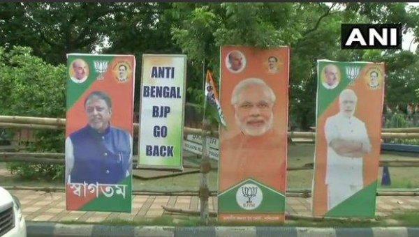 `வரவேற்புப் பேனர்களுக்கிடையில் #GoBackBJP ஃப்ளெக்ஸ்!' - அமித் ஷாவைக் கடுப்பேற்றிய திரிணாமுல் காங்கிரஸ்